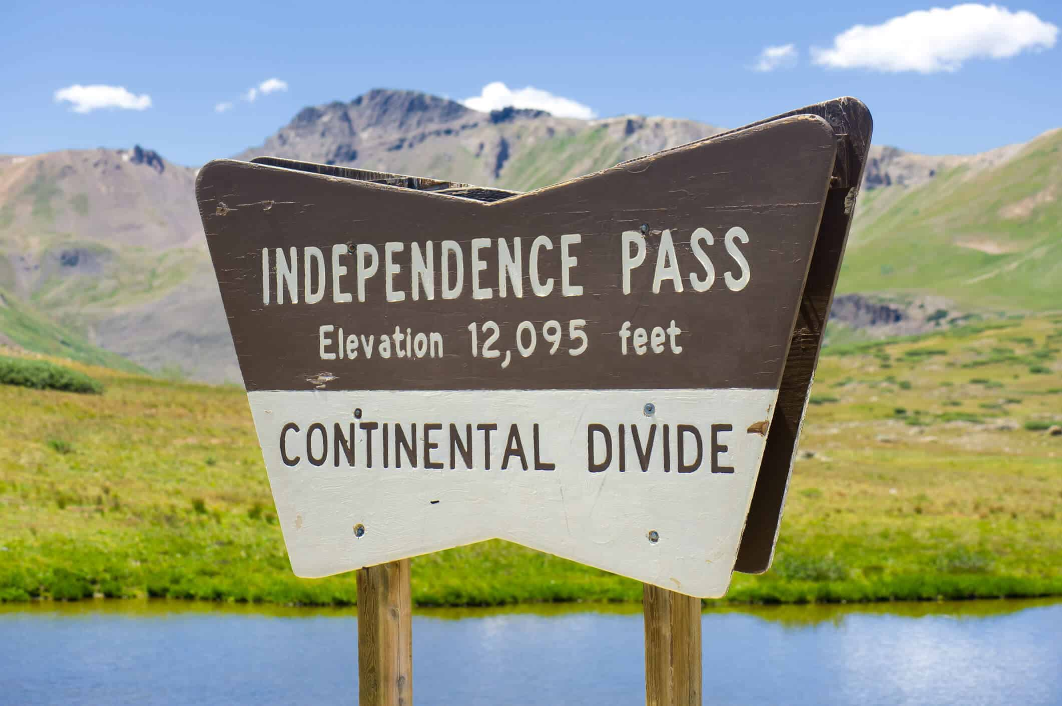Independence Pass Aspen Colorado. Wood sign indicating the top of scenic mountain pass off of scenic bi-way road in the Rocky Mountains of Colorado. Elevation 12,095 Feet.